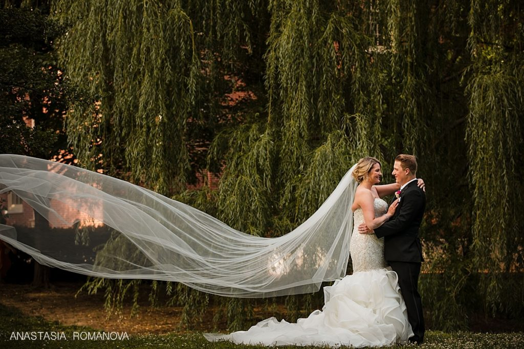 Dramatic wedding photos of the veil by the 18th Century Gardens